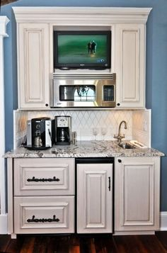 Love a tiny kitchen(coffee station). Micro, sink,  refrigerator drawers. All you need. girlofthehollow