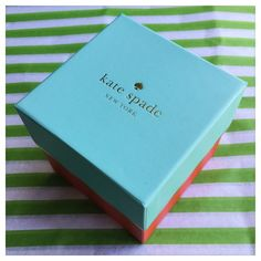 "♠️ Authentic Kate Spade Watch Box with Pillow ♠️ ♠️ Authentic Kate Spade Watch Box with Pillow ♠️ Brand new, no defects, perfect condition! ♠️ Please note that this lot is just for the watch box (two pieces - top & bottom) and the interior pillow that the watch fits around. ♠️ Exterior is blue and red with gold foiling -- exterior is cream with gold dot foiling and reads ""live colorfully"" ♠️ Dimensions: 3.5"" x 3.5"" x 3.5"" ♠️ Please ask any questions you may have!  No Trades!  kate spade…"