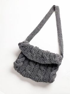 Ribbed Cable Purse in Lion Brand Wool-Ease - 50607B. Discover more Patterns by Lion Brand at LoveKnitting. The world's largest range of knitting supplies - we stock patterns, yarn, needles and books from all of your favorite brands.