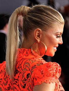 Keep a few strands out when you put your hair in a ponytail to wrap around your hair tie like Fergie.