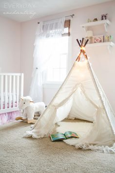 A Littler Retreat | We created this little reading retreat for the nursery with a lace teepee from Sugar Shacks Teepees.