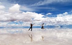 Salar de Uyuni, Bolivia.  This is the world's largest salt flat, but it looks like they're in midair bouncing on clouds.