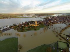 TEWKESBURY, UNITED KINGDOM - JANUARY 05: The Tewkesbury Abbey is seen surrounded by flood water on January 5, 2014 in Tewkesbury, United Kingdom.