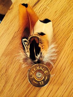 First attempt at a Shotgun cartridge and feather badge/pin
