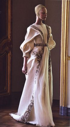 Alexander McQueen. Reminiscent of Vermeer's girl with a pearl earring.