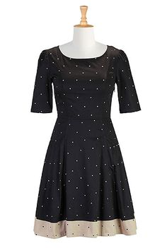 I <3 this Polka dot colorblock dress from eShakti  -  black and tan/beige.  check out the entire site, nice clothes with tailoring available, decent prices, fast service, very large size range.        lj