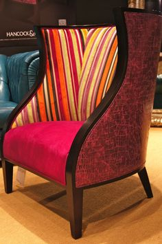"(Click to view larger) A star on it's own, the ""Serpentine chair"" from Hancock & Moore is dressed in a fashion forward look with three fabric application.  The modified barrel back has a dark frame with just the right amount of curves.  Let's get this party started in green, orange and pink velvet stripe, the exterior  is covered in magenta crocodile and the seat is a hot pink sueded leather.  Hancock & Moore 200 Steele Blg 2nd floor.  #hpmkt  http://lisamendedesign.blogspot.com"