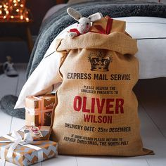 personalised christmas sack by harrow & green...Want to get one for me and chris for our first christmas in our first home :)