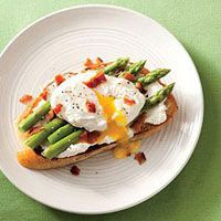 Ricotta Toasts with Asparagus and Poached Eggs These little slices of country bread are topped with heaven: creamy ricotta cheese, fresh steamed asparagus, crumbled bacon and a pleasantly poached egg. Use a fork or dare to devour utensil-less. Just be sure to keep some napkins around!