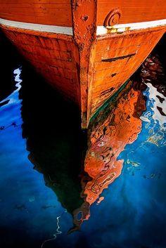 Orange boat on blue water.