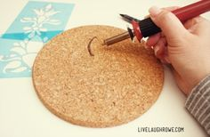 Start burning design onto the cork trivet with woodburning pen