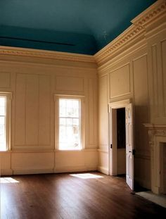 Cream paneling and a deep turquoise, vaulted ceiling. The millwork - I die.