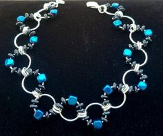 Onyx and Hematite Wave Chainmaille Bracelet. Onyx Root Chakra A powerful protection stone, it absorbs and transforms negative energy and helps to prevent the drain of personal energy. Use to encourage happiness and good fortune. Hematite Root Chakra A grounding stone for the