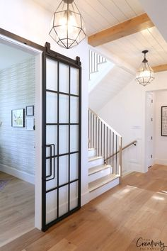 Farmhouse Home Tour: Millhaven Homes Modern farmhouse hallway with statement pendants and wood floors.Modern farmhouse hallway with statement pendants and wood floors. Modern Farmhouse Kitchens, Farmhouse Interior, Farmhouse Style Kitchen, Modern Farmhouse Style, Farmhouse Homes, Home Decor Kitchen, Rustic Farmhouse, Farmhouse Office, Rustic Modern