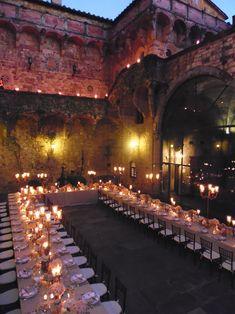 The U shape Imperial Table gives the idea of a feast in the romantic Castello di Vincigliata Castle. All Rights Reserved GUIDI LENCI www.guidilenci.com
