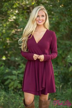 This beautiful wrap dress is sure to steal your heart away! We are in love with the beautiful wine color paired with the classic wrap style - it's just an essential for date night! We also love the soft, lightweight material - it's perfect for those cool fall days without being too heavy!