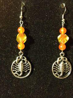 Orange and Yellow Scorpion Earrings by queenofqeeks on Etsy, $8.00