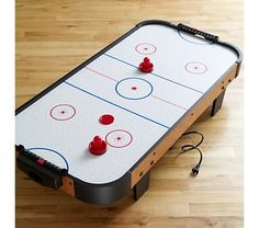 Air hockey- this could be fun :) All Toys, Kids Toys, Air Hockey Games, Games For Toddlers, Kid Table, Baby Store, Easy Gifts, Crate And Barrel, Kids Furniture