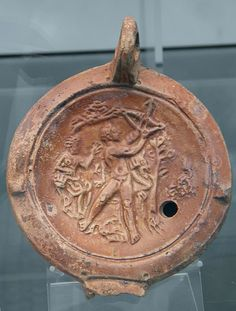 File:Clay oil lamp depicting Hercules defeating the Stymphalian Birds (the Sixth Labour), Staatliche Antikensammlungen, Munich (8957464087).jpg