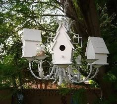 """Pinner said, birdhouse chandelier she made from Goodwill chandy and unfinished birdhouses from Michaels. Just hit the whole thing with white spray paint and hung on tree in back yard. In between birdhouses are tea cups and saucers for seed or water."""