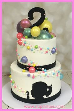 Candy bubbles!  Two tier cake with blowing bubble silhouette and candy bubbles wrapping around they cake as they float up to the sky.  Large bubbles on top I made from white chocolate and painted with with luster dust.