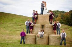 outdoor wedding decorations with hay bails | Wedding photo with hay bales