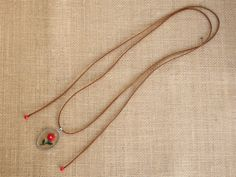 Brown suede necklace with hand-embroidered flower pendant by MontradaCarolina on Etsy