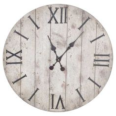 If you're looking for wall decor that goes perfectly with your vintage style, then the Pine Finish Wood Wall Clock from Threshold™ is the perfect addition to your home. This hanging wall clock features a weathered design for a vintage look and is made with distressed wood. This large wooden clock is a rustic and functional addition to any room in your home.