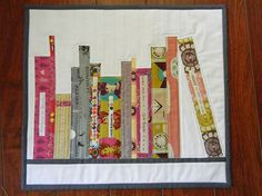A book shelf themed mini-quilt! @Stephanie L. I thought about you when I saw this, as I do anything book-related.  ;)