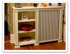 Another great radiator cover idea with added shelves on the side and on top.