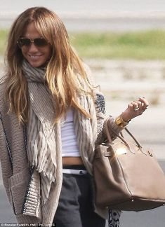 64b75555392 Beaming Jennifer Lopez looks radiant as she flies to Miami