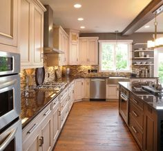country kitchen paint color wood floor wall shelves backsplash chandelier ceiling ligths cabinets window stove dark countertop traditional kitchen of Inspiring Country Kitchen Paint Colors to Get Inspirations From