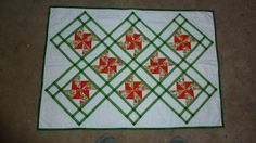 Spring Pinwheels Tulip Table Mat 25 x 34.  by Quiltbuilders