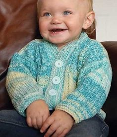 """Knitting Pattern for Ribbed Baby Cardigan - Knit flat in pieces and seamed, this simple baby cardigan sports an allover rib pattern edged in garter stitch. Sizes: 18(20,23,25)"""" to fit up to 0(3,12,24) months. Great with self-striping or multi-color yarn!"""