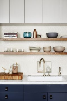 open shelving in kitchen // white backsplash // navy lower cabinets // white upper cabinets // white countertops