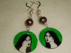 Hand-colored shrink art featuring design by April with pearls earrings.