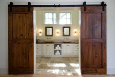 Image from http://cdn.freshome.com/wp-content/uploads/2013/11/rustic-barn-conversion-bathroom-doors.jpg.