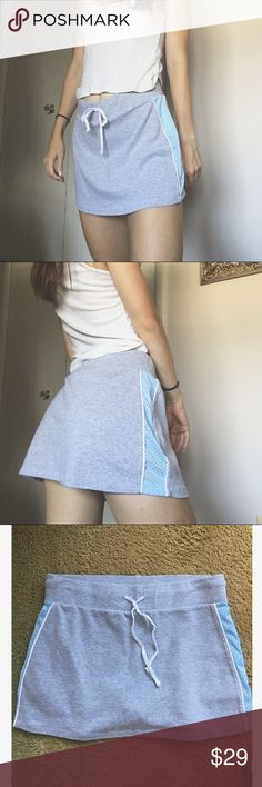 Grey & Blue Athletic Skirt Only the most adorable little athletic skirt ever. Baby blue mesh stripes on the side and built! in! shorts!! Excellent condition! Best fits a size small. Drawstring feature to adjust to size. Listed Brandy for exposure. Brandy Melville Skirts Mini