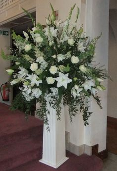 The Herb of Grace Wedding Flowers Farnham, large pedestal of lily, gladioli, ruscus, aster, cream roses, larkspur, astilbe