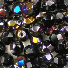 Jet Sliperit 6mm top-quality Czech fire-polished, faceted, round glass beads.  Sparkly part opaque black, part metallic purple, blue and gold iris rainbow finish. UK seller.
