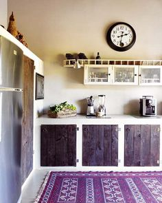 perfect cupboard design - add dark stained, bashed up wood worktop, flush to the cupboard sides. painted concrete floor, same color as the cupoard surrounds.