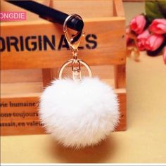 Super Cute Pom Pom Fur ball 100% brand new. Trending hot in 2016. Goes well with your keys, purse, wallet, phone, camera or basically anything. Different colors to choose from that are pale pink, hot pink, white, grey and lavender. Make an offer while they last. Price firm. Any questions are welcome. Thank you and namaste  Accessories