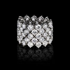 Diamond ring, sixty-five round-brilliant-cut G+ diamonds totaling 13.03 carats, hand-crafted in platinum.