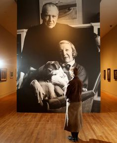 A visitor to the National Gallery before a portrait of Alex Colville and Rhoda Colville, with one of their many dogs. (Julie Oliver, Ottawa Citizen)
