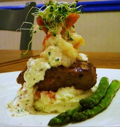 Filet Mignon, garlic butter poached shrimp, truffle infused mashed potatoes, fresh asparagus and a creamy smoked bacon, chive & crab sauce. Thanks Jimmy @http://www.facebook.com/pages/Grecians-Greek-Italian/
