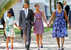 US President Barack Obama, First Lady Michelle Obama and their daughters Malia and Sasha(L) walk to St John's Church across from the White House in Washington, DC, on July 17, 2011 to attend a Sunday prayer service . AFP Photo/Jewel Samad (Photo credit should read JEWEL SAMAD/AFP/Getty Images)