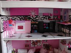 A girl and a glue gun: DIY Barbie House/ GREAT videos at end for washer/dryer and a 4 poster bed using cereal box, pencils, and duct tape. Sooo fun