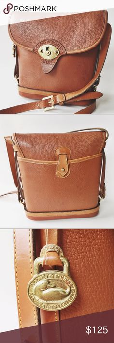 """Vintage Dooney & Bourke Cognac Crossbody Classic beauty! I finally convinced my mother in law to let me sell a couple of her Dooneys 🙌🏼 This one is a gorgeous structured cognac pebbled leather crossbody in very beautiful vintage condition. Trust me, these are her babies, and I totally get the fuss over these bags now! Exceptionally well made. Has all weather logo and classic duck fob. Solid brass hardware. Bag measures 10"""" tall and 9.5"""" wide 18-20"""" drop on the adjustable strap. Dooney…"""