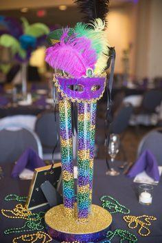 Mardi gras centerpiece for a Bat Mitzvah!  Beads, masks, glitter!