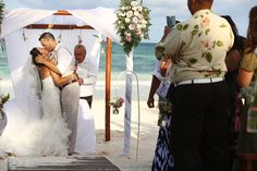 You may now kiss the bride! Newlyweds celebrate with a kiss at their destination wedding at Akiin Beach Club in Tulum. Mexico wedding photographers Del Sol Photography.